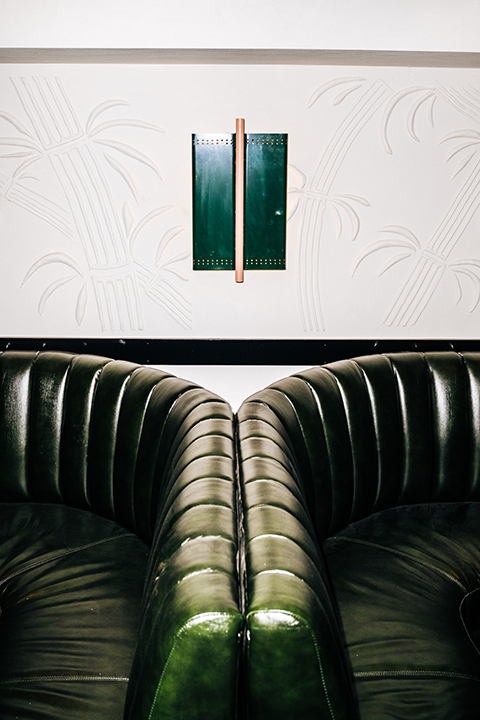 Green leather booths and rendered wall Golden Boy Cellar