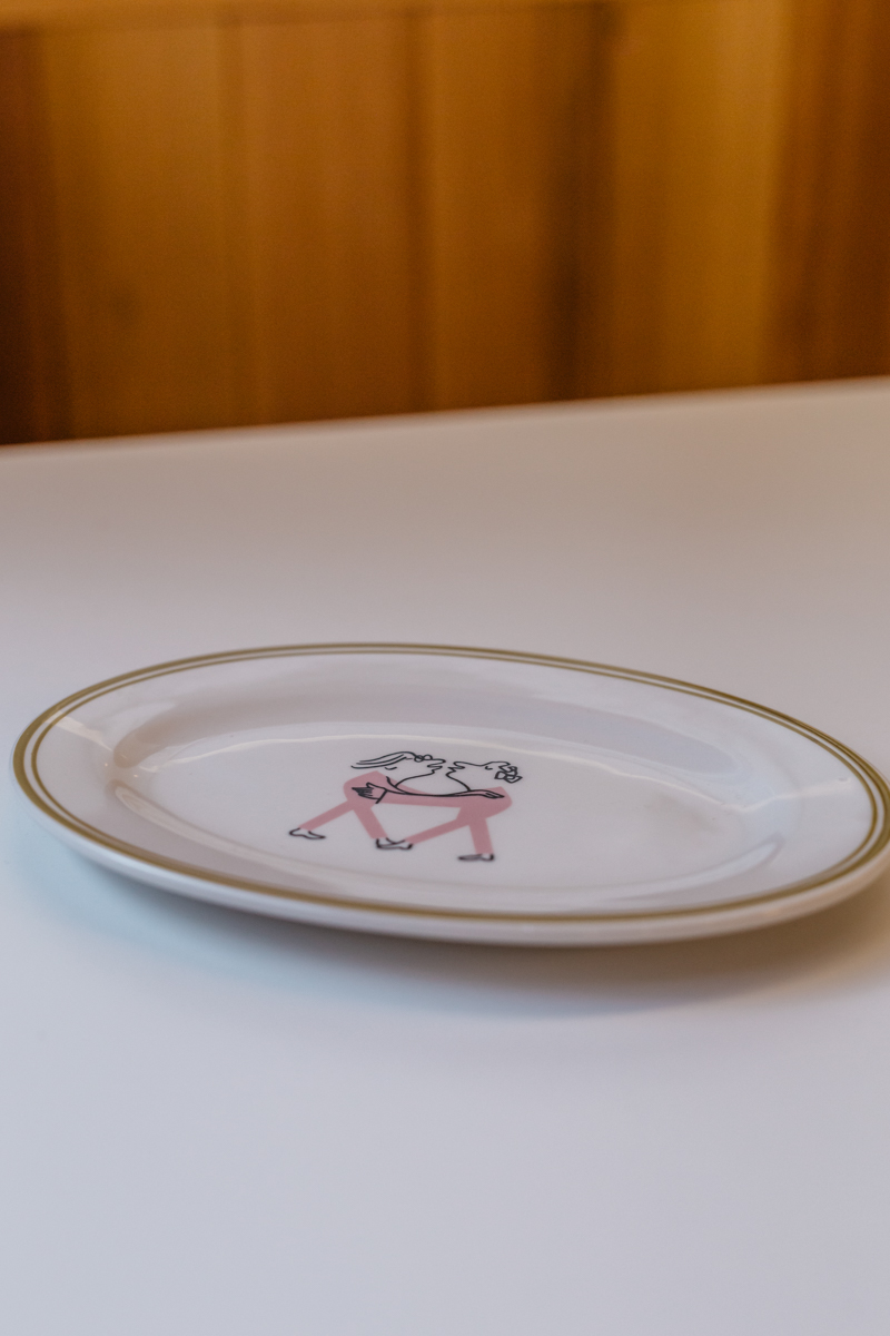 Photo of oval plate featuring Part Time Lover illustrator –Alec Doherty's work